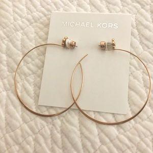 Michael Kors hoop earrings.